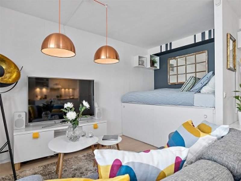 decoração apartamento que mostra a importância das almofadas na decoração